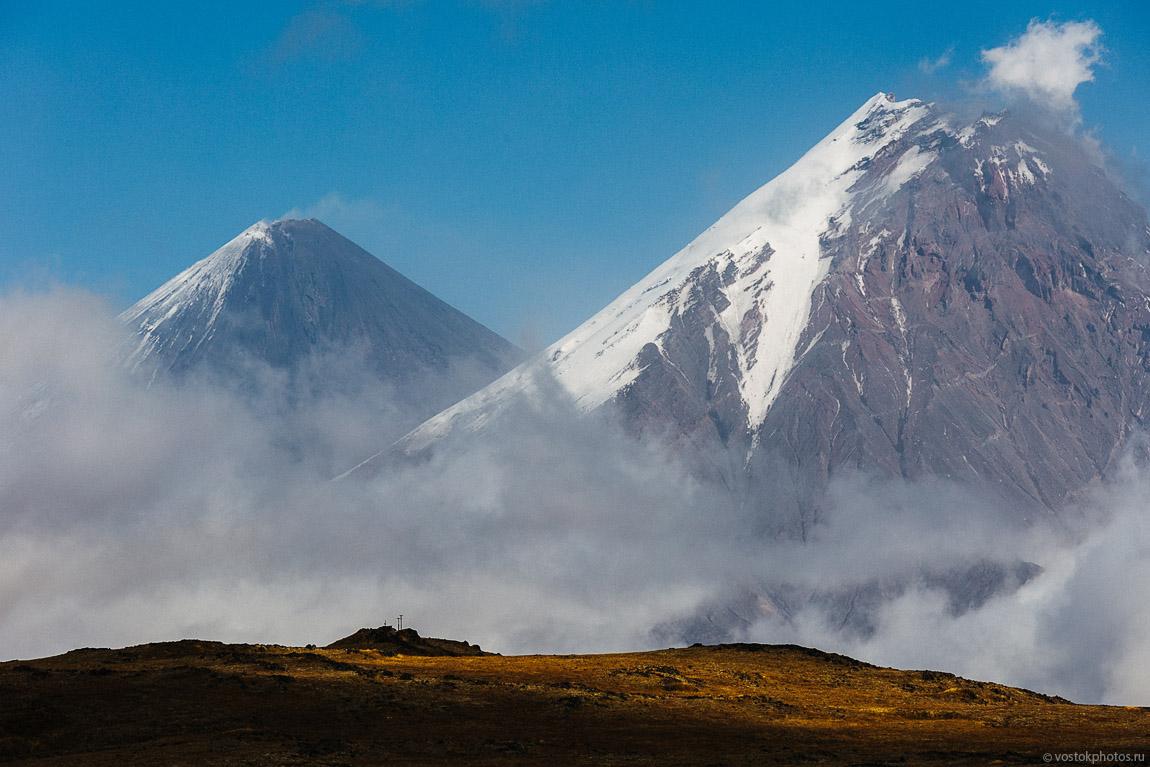 Lava flow of the Tolbachik Volcano, Mount Kamen and Klyuchevskaya Sopka